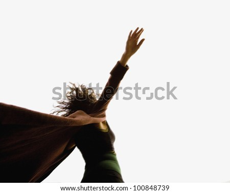 Low angle view of woman with arms out