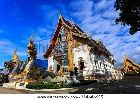 Low angle view Wat Khrua Khrae (Wat Mangkol Thawararam) temple in Chiang Rai, Thailand - stock photo