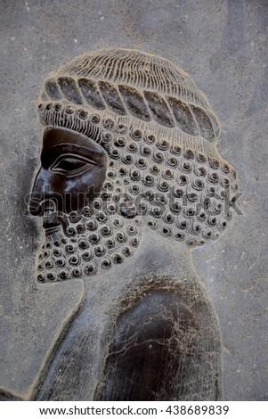 Low (bas) relief in Persepolis, Iran, head of a man - stock photo