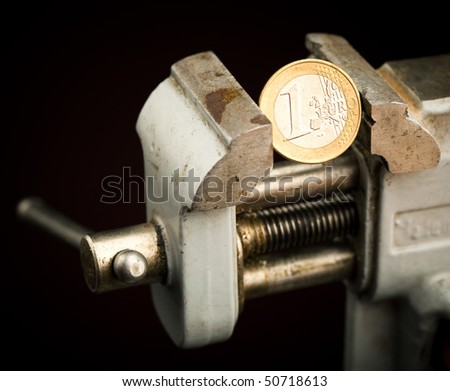 low budget - money in the vice - stock photo
