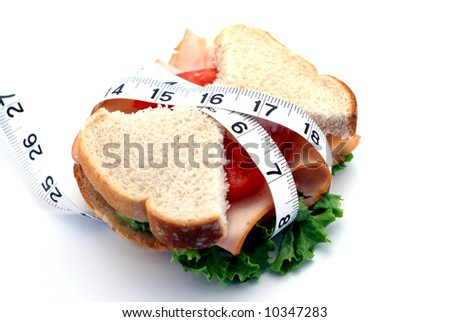 Low-carb diet concept with skinny bread slices on a sandwich - stock photo