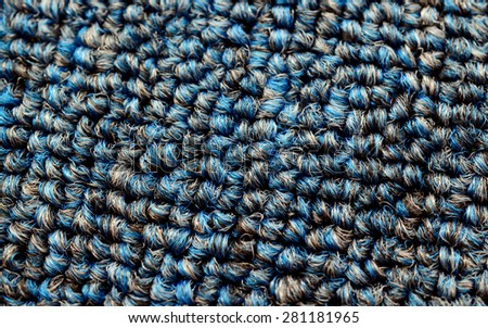 Low close up view of a beige furry carpet texture background, full frame. - stock photo