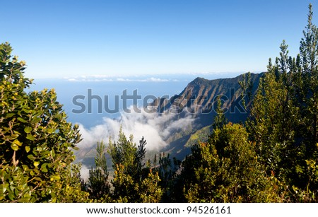 Low clouds start to form on Kalalau valley in Kauai Na Pali Coast - stock photo