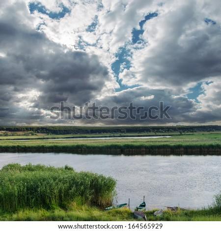 low darken clouds over river - stock photo