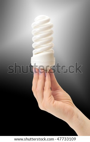 low-energy bulb in hand