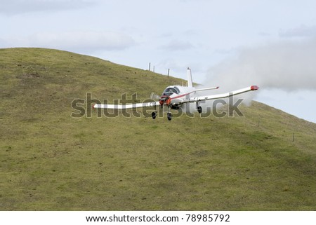 Low Flying Crop Duster Spraying Fertilizer - stock photo