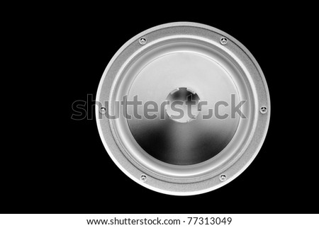 Low frequency loudspeaker (inverted) on a black background. - stock photo