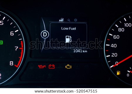 Low Fuel Sign Additional Instruments On Stock Photo - Car sign on dashboard