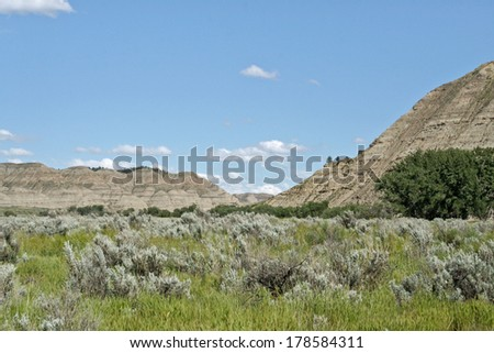 low hills in a valley of the river missouri in montana - stock photo