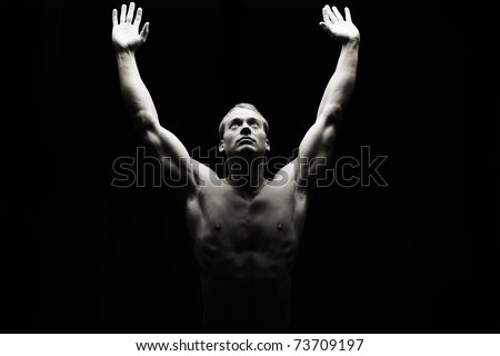 Low key artistic fitness man - stock photo