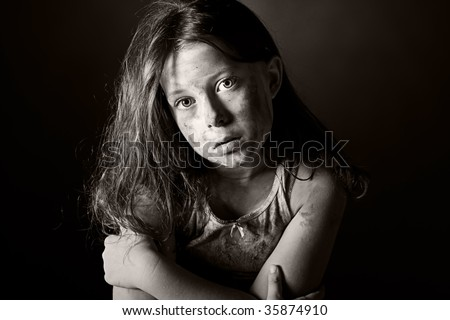 Low Key Black and White Shot of a Scared and Filthy Brown Haired Child - stock photo