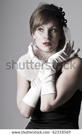 low key dramatic shot of a beautiful vintage styled 1930s girl
