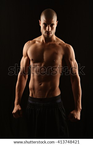 Low key fitness man from front - stock photo