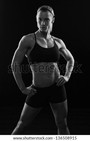 Low key fitness woman - stock photo