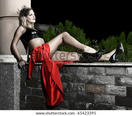 Low key image of fasion model outdoor - stock photo