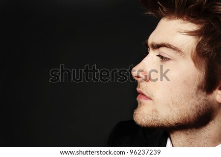 low key image of side profile of a young man