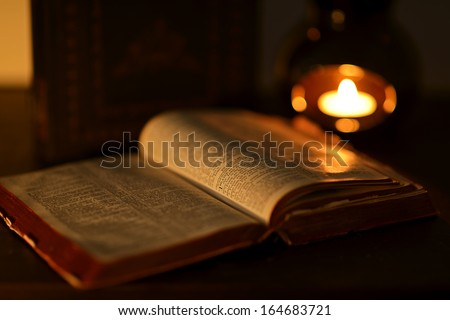 Low key image of the bible - stock photo