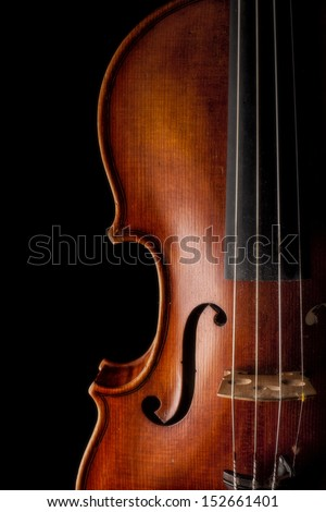 Low key image showing part of a violin - stock photo