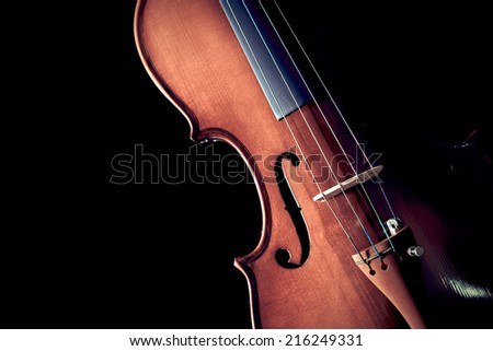 Low Key Image showing part of Violin & Beautiful Rim Light of Classical Violin Shape , isolated - stock photo