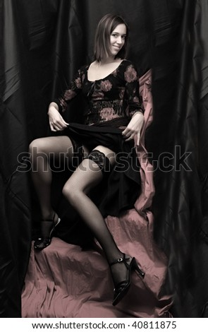 Low key lighting studio shot young beautiful women on pink background. Great image for calendar. - stock photo