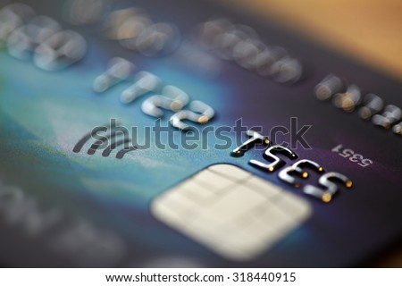 Low key macro shot with credit card. - stock photo
