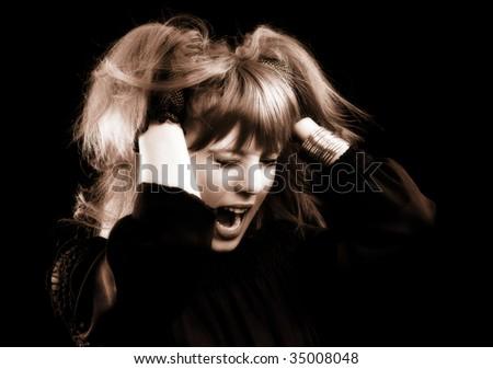 Low key monochrome portrait of a desperate emo girl - stock photo