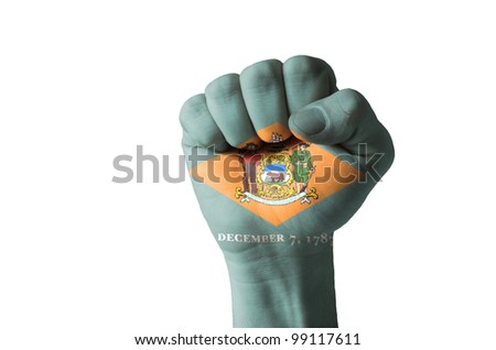 Low key picture of a fist painted in colors of american state flag of delaware - stock photo