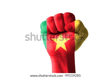 Low key picture of a fist painted in colors of cameroon flag