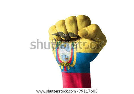 Low key picture of a fist painted in colors of ecuador flag - stock photo