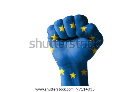 Low key picture of a fist painted in colors of europe flag - stock photo