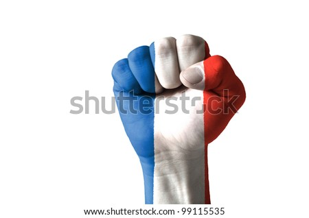 Low key picture of a fist painted in colors of france flag - stock photo
