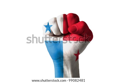 Low key picture of a fist painted in colors of panama flag - stock photo