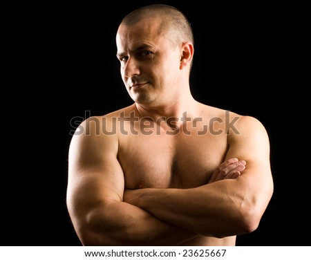 low key portrait of a muscular young man