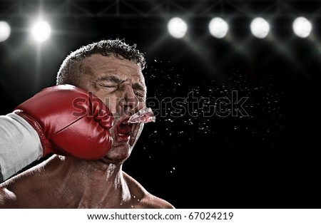 low key portrait of boxer getting knocked out