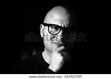 Low key portrait of the attractive man  - stock photo