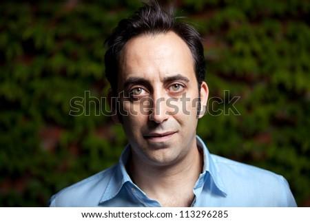 Low Key serious portrait of a man - stock photo