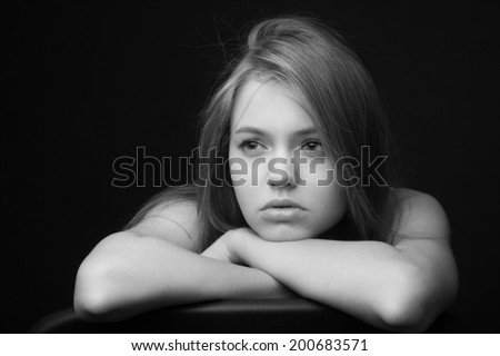 Low Key shoot of beautiful sad and thoughtful girl - stock photo