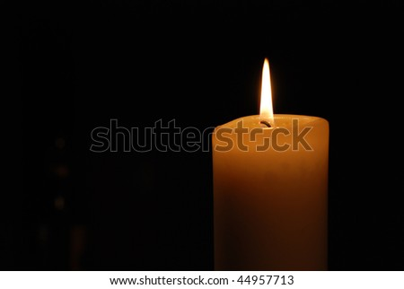 Low Key shot of a burning candle - stock photo
