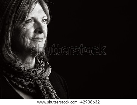 Low Key Shot of a Happy Senior Lady - stock photo