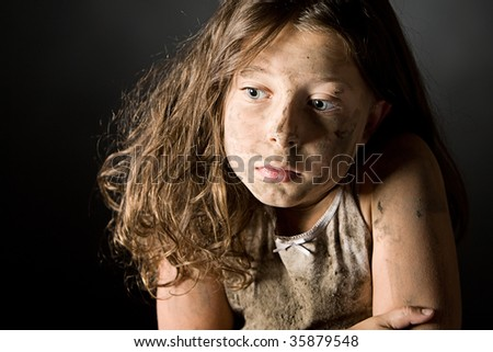 Low Key Shot of a Scared and Filthy Brown Haired Child - stock photo