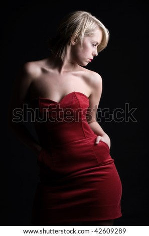 Low Key Shot of a Stunning Blonde Girl in Red Dress - stock photo