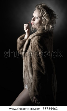 Low Key Shot of Vintage Styled Woman in Fur Coat - stock photo