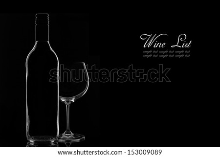 Low-key Studio Shot of a Wine Bottle and a Wine Glass on a Black Background.Copy Space. - stock photo