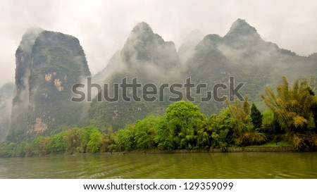 Low-Lying Clouds Shroud Limestone Outcroppings on a Drizzly Day - Li River, Guilin, China