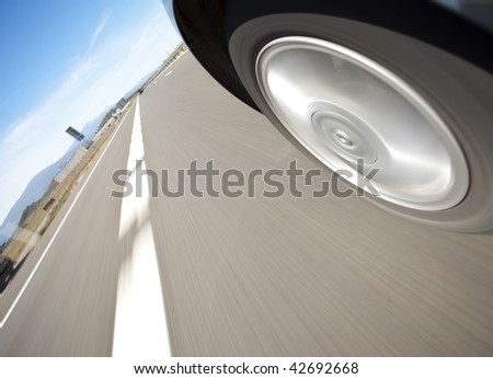 Low point of view at high speed under blue sky. - stock photo