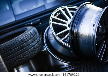 Low Profile Tires and Rims in the Garage. Transportation Photo Collection. - stock photo
