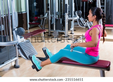 low pulley rows woman wide grip seated girl workout gym exercise - stock photo