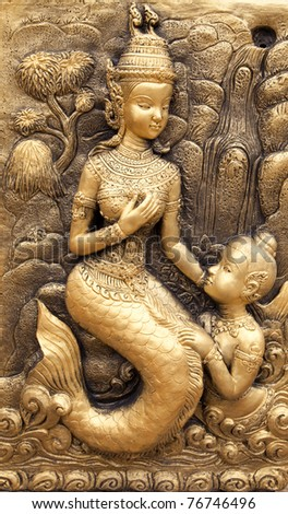 Low-relief image of Thai traditional art illustrated mermaid and son from a tale.