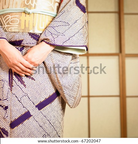 Low section close up of Asian woman standing - stock photo