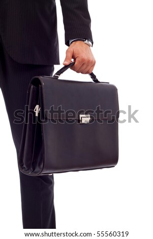 Low section image of a business person holding a suitcase